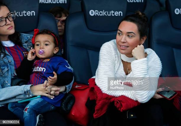 Aine Coutinho wife of Philippe Coutinho and Maria Coutinho child of Philippe Coutinho are seen at Camp Nou on January 8 2018 in Barcelona Spain The...