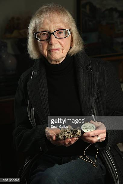 Aini Teufel who survived the February 13 1945 firebombing by Allied planes of the city of Dresden poses holding a molten remain of her elementary...