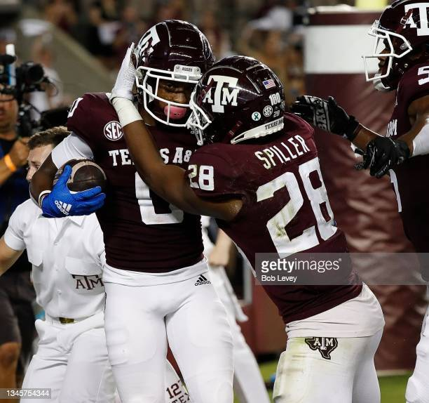 Ainias Smith of the Texas A&M Aggies celebrates with Isaiah Spiller after catching a 6 yard pass for a touchdown in the first half against the...