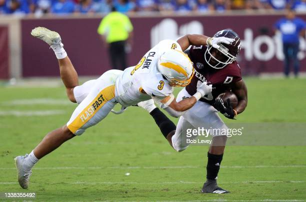 Ainias Smith of the Texas A&M Aggies is tackled by Dean Clark of the Kent State Golden Flashes at Kyle Field on September 04, 2021 in College...