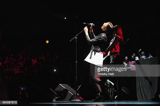 Aino Jawo and Caroline Hjelt of Icona Pop perform onstage during 103.5 KISS FM's Jingle Ball 2013, presented by Jam Audio Collection, at United...