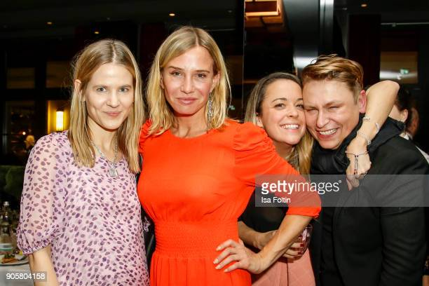 Aino Labarenz German actress Nadeshda Brennicke Designer Marina Hoermanseder and Designer Dawid Tomaszewski during the Grazia Fashion Dinner at...