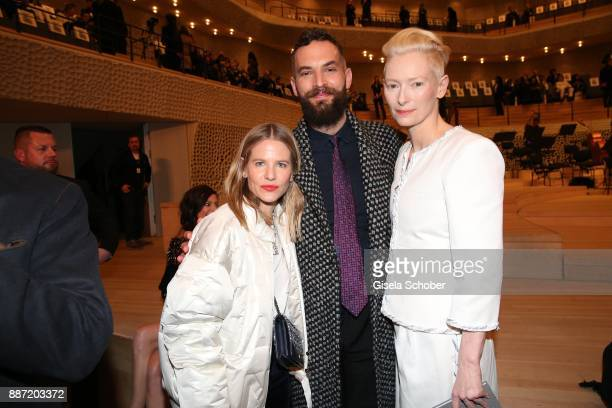 Aino Laberenz Sandro Kopp and Tilda Swinton during the Chanel 'Trombinoscope' Collection des Metiers d'Art 2017/18 photo call at Elbphilharmonie on...