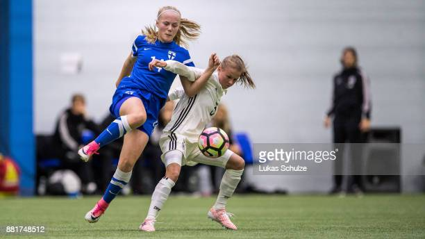 Aino Vuorinen of Finland and Laura Donhauser of Germany fight for the ball during the U17 Girls friendly match between Finland and Germany at the...
