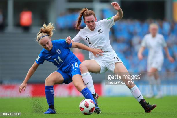 Aino Vuorinen of Finland struggles for the ball with Mackenzie Barry of New Zealand during the FIFA U17 Women's World Cup Uruguay 2018 group A match...