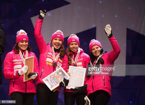 AinoKaisa Saarinen Laura Mononen Kerttu Niskanen and Krista Parmakoski of Finland during the medal ceremony after the women's cross country relay...