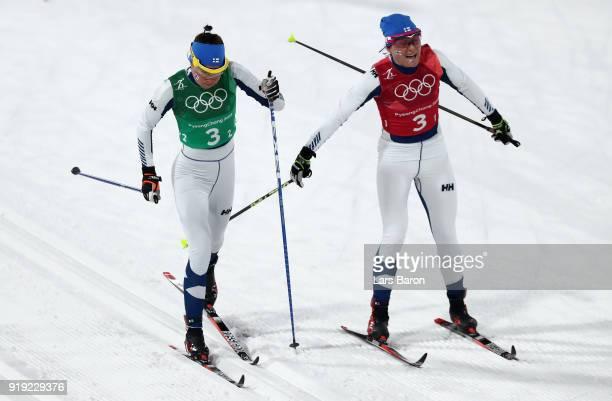 AinoKaisa Saarinen of Finland hands over to Kerttu Niskanen of Finland during the Ladies' 4x5km Relay on day eight of the PyeongChang 2018 Winter...
