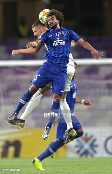 Ain's forward Marcus Berg vies for the header with Hilal's defender Yasser AlShahrani during the AFC champions league Group C football match between...