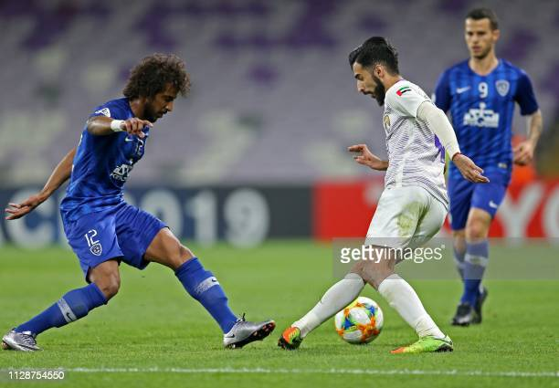 Ain's midfielder Bandar AlAhbabi vies for the ball with Hilal's defender Hassan Kadesh during the AFC champions league Group C football match between...