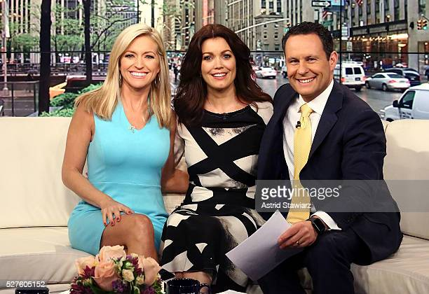 Ainsley Earhardt Bellamy Young and Brian Kilmeade pose for photos during 'Fox Friends' at FOX Studios on May 3 2016 in New York City