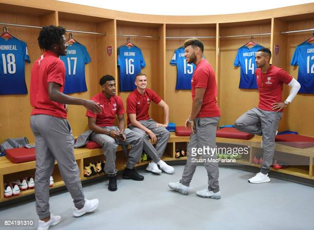 Ainsley MaitlandNiles Alex Iwobi Rob Holding Alex OxladeChamberlain and Theo Walcott in the Arsenal changing room before the Emirates Cup match...