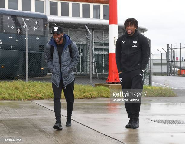 Ainsley MaitlandNiles and Alex Iwobi of Arsenal arrive for the team flight to Rennes at Luton Airport on March 06 2019 in Luton England