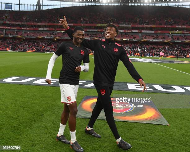 Ainsley MaitlandNiles and Alex Iwobi of Arsenal before the UEFA Europa League Semi Final leg one match between Arsenal FC and Atletico Madrid at...