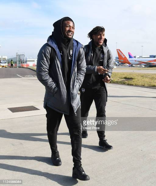 Ainsley MaitlandNiles and Alex Iwobi of Arsenal board the plane at Luton Airport on February 13 2019 in Luton England
