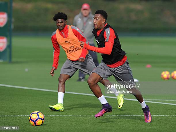 Ainsley Maitland-Niles and Alex Iwobi of Arsenal during a training session at London Colney on November 3, 2016 in St Albans, England.