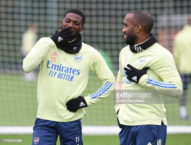 Ainsley MaitlandNiles and Alex Lacazette of Arsenal during a training session at London Colney on October 03 2020 in St Albans England