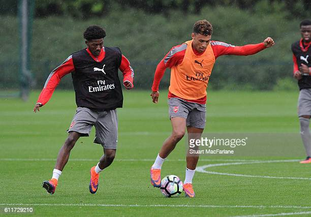 Ainsley Maitland-Niles and Alex Oxlade-Chamberlain of Arsenal during a training session at London Colney on October 1, 2016 in St Albans, England.