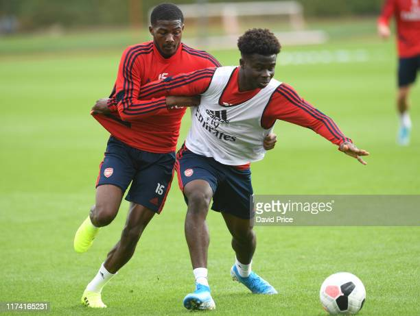 Ainsley Maitland-Niles and Bukayo Saka of Arsenal during the Arsenal Training Session at London Colney on September 12, 2019 in St Albans, England.