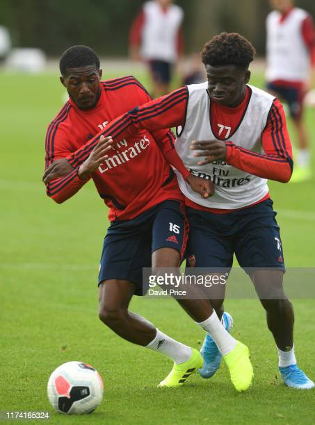 Ainsley Maitland-Niles and Buyako Saka of Arsenal during the Arsenal Training Session at London Colney on September 12, 2019 in St Albans, England.