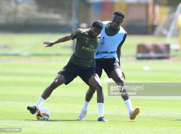 Ainsley Maitland-Niles and Danny Welbeck of Arsenal during a training session at London Colney on May 21, 2019 in St Albans, England.