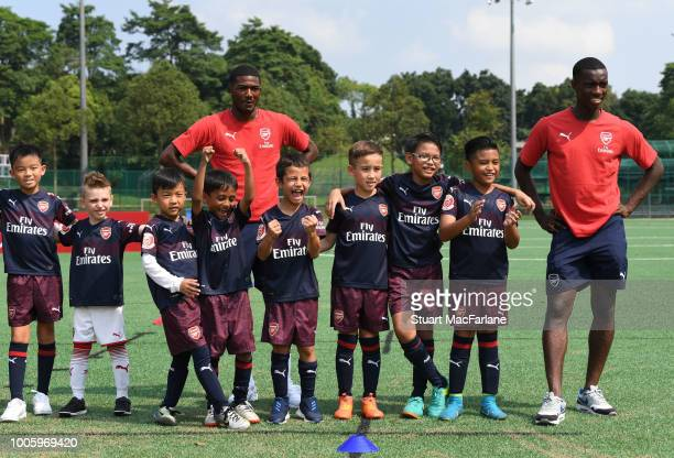 Ainsley MaitlandNiles and Eddie Nketiah attend an Arsenal Soccer Clinic at the Singapore American School on July 27 2018 in Singapore