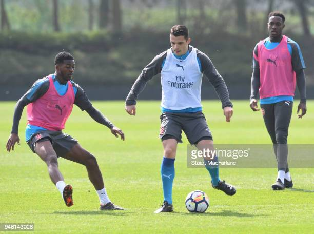 Ainsley MaitlandNiles and Granit Xhaka of Arsenal during a training session at London Colney on April 14 2018 in St Albans England