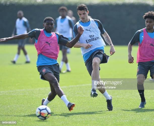 Ainsley MaitlandNiles and Granit Xhaka of Arsenal during a training session at London Colney on April 21 2018 in St Albans England