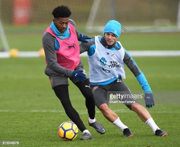 Ainsley MaitlandNiles and Jack Wilshere of Arsenal during a training session at London Colney on February 2 2018 in St Albans England