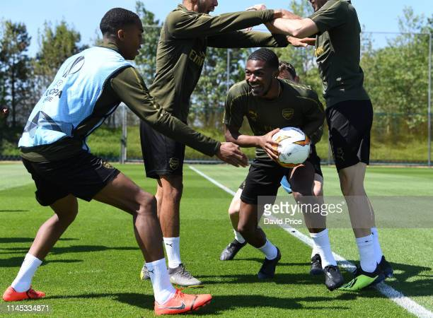 Ainsley Maitland-Niles and Joe Willock of Arsenal during the Arsenal Training session at London Colney on May 21, 2019 in St Albans, England.