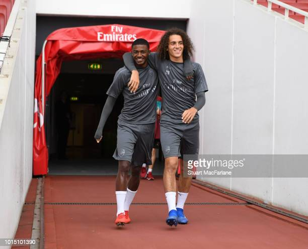 Ainsley MaitlandNiles and Matteo Guendouzi of Arsenal before a training session at Emirates Stadium on August 11 2018 in London England