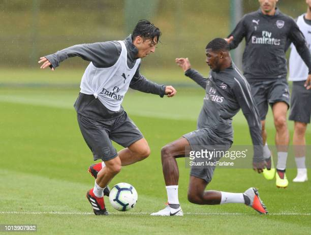 Ainsley MaitlandNiles and Mesut Ozil of Arsenal during a training session at London Colney on August 10 2018 in St Albans England