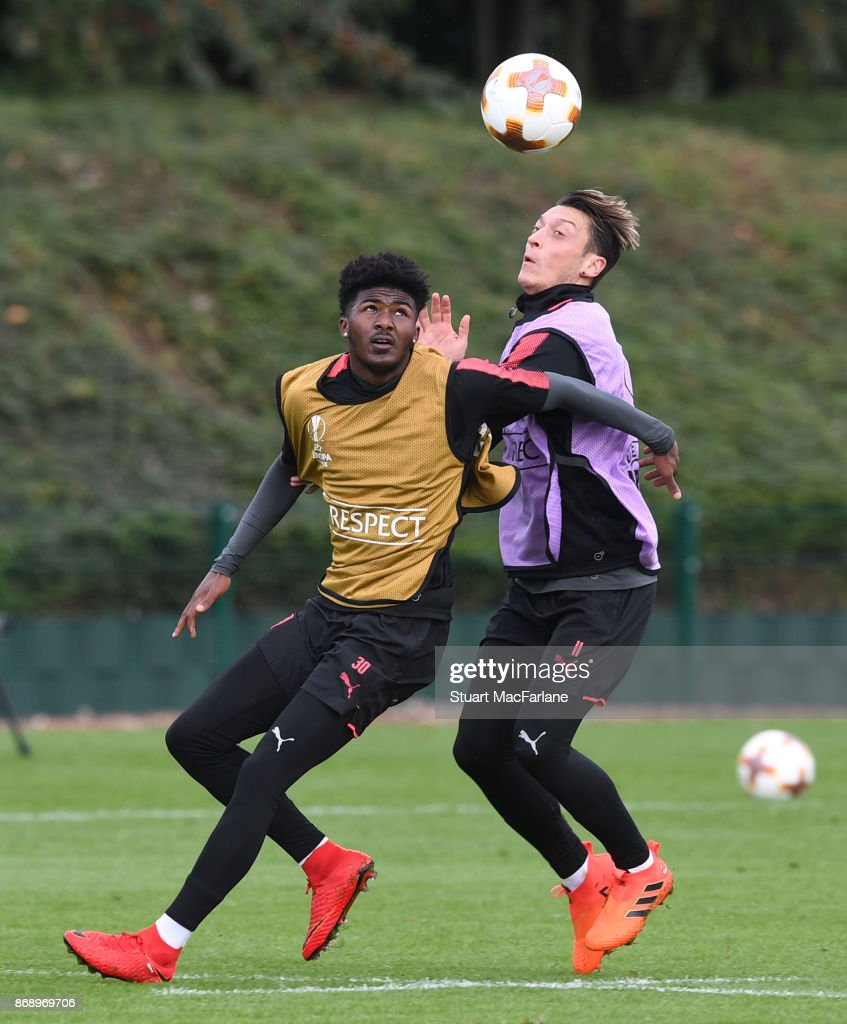Ainsley Maitland-Niles and Mesut Ozil of Arsenal during a training session at London Colney on November 1, 2017 in St Albans, England.