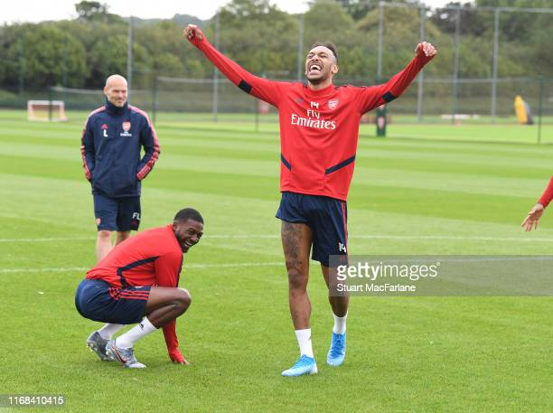 Ainsley Maitland-Niles and Pierre-Emerick Aubameyang of Arsenal during a training session at London Colney on August 16, 2019 in St Albans, England.