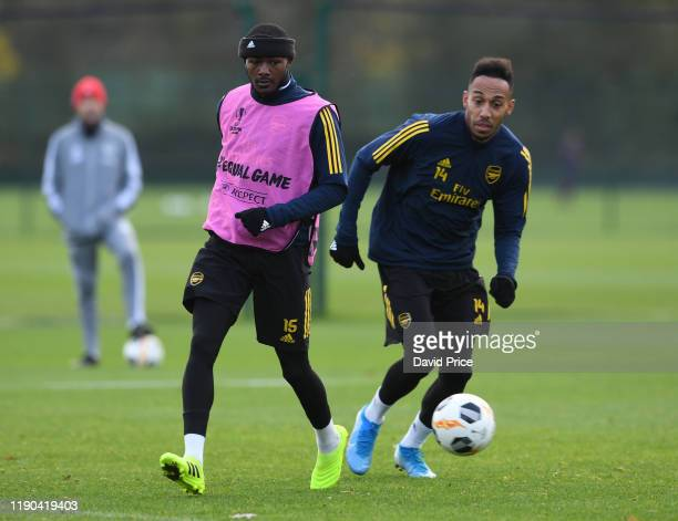 Ainsley Maitland-Niles and Pierre-Emerick Aubameyang of Arsenal during Arsenal Training Session at London Colney on November 27, 2019 in St Albans,...