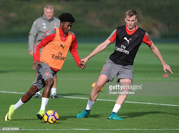 Ainsley Maitland-Niles and Rob Holding of Arsenal during a training session at London Colney on November 3, 2016 in St Albans, England.
