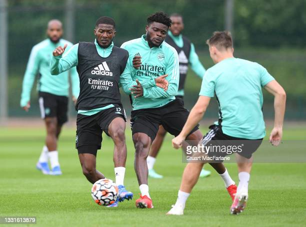 Ainsley Maitland-Niles and Thomas Partey of Arsenal during a training session at London Colney on July 30, 2021 in St Albans, England.