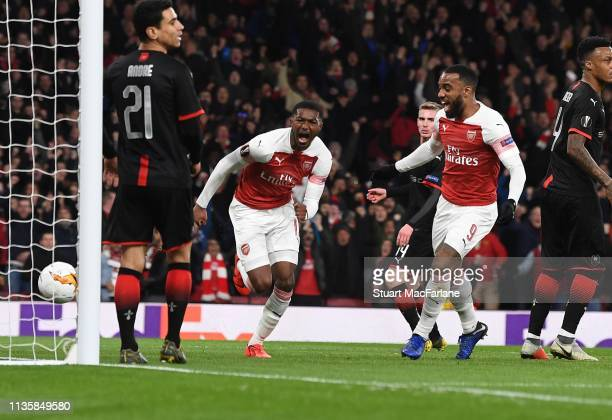 Ainsley MaitlandNiles celebrates scoring the 2nd Arsenal goal with Alex Lacazette during the UEFA Europa League Round of 16 Second Leg match between...