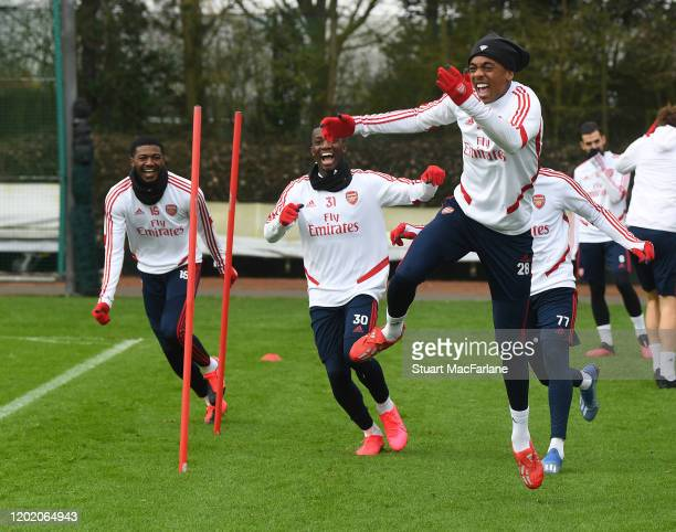 Ainsley Maitland-Niles, Eddie Nketiah and Joe Willock of Arsenal during a training session at London Colney on January 26, 2020 in St Albans, England.