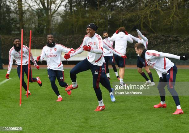 Ainsley Maitland-Niles, Eddie Nketiah, Joe Willock and Rob Holding of Arsenal during a training session at London Colney on January 26, 2020 in St...