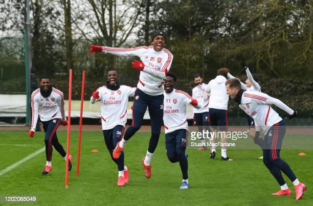 Ainsley Maitland-Niles, Eddie Nketiah, Joe Willock, Bukayo Saka and Rob Holding of Arsenal during a training session at London Colney on January 26,...