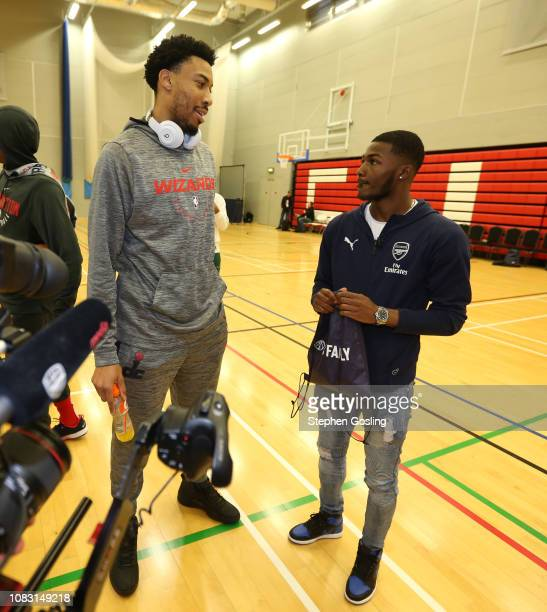 Ainsley Maitland-Niles from Arsenal Football Club greets Otto Porter Jr. #22 of the Washington Wizards during practice as part of the 2019 NBA London...