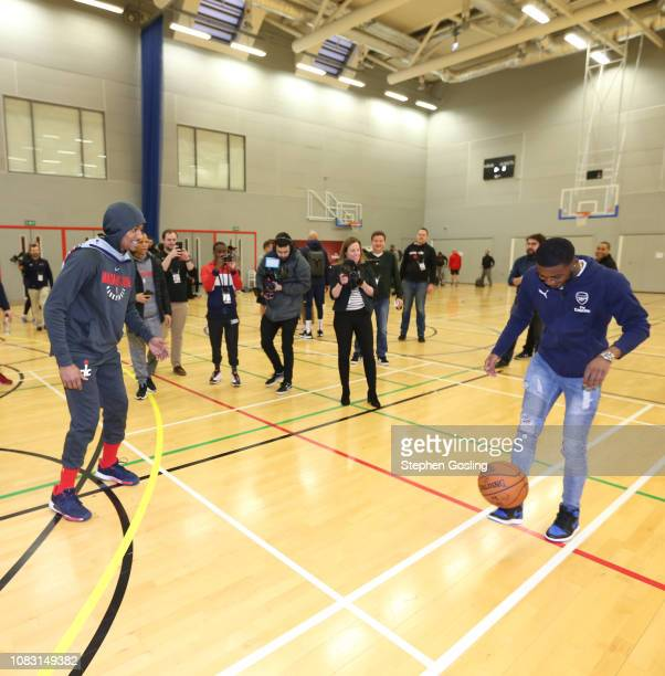 Ainsley Maitland-Niles from Arsenal Football Club kicks a basketball during practice as part of the 2019 NBA London Global Game at Citysport on...