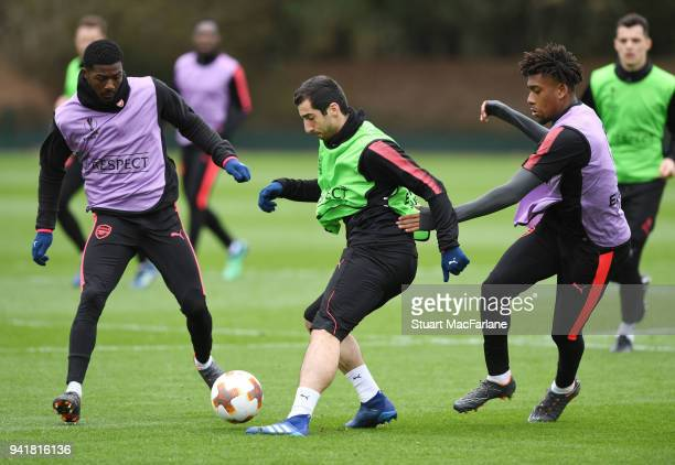 Ainsley MaitlandNiles Henrikh Mkhitaryan and Alex Iwobi of Arsenal during a training session at London Colney on April 4 2018 in St Albans England