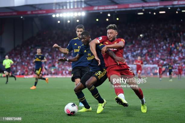 Ainsley MaitlandNiles of Arsenal and Alex OxladeChamberlain of Liverpool battle for possession during the Premier League match between Liverpool FC...