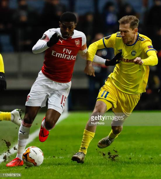 Ainsley MaitlandNiles of Arsenal and Alexander Hleb of BATE Borisov vie for the ball during the UEFA Europa League Round of 32 first leg match...