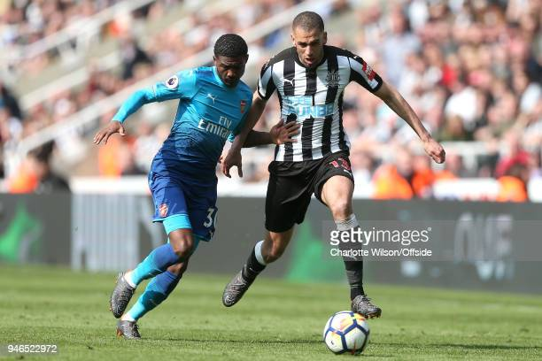 Ainsley MaitlandNiles of Arsenal and Islam Slimani of Newcastle battle for the ball during the Premier League match between Newcastle United and...