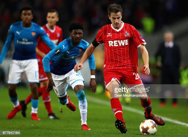 Ainsley MaitlandNiles of Arsenal and Lukas Kluenter of FC Koeln battle for possession during the UEFA Europa League group H match between 1 FC Koeln...