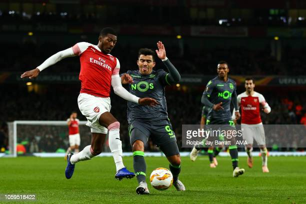Ainsley Maitland-Niles of Arsenal and Marcos Acuna of Sporting CP during the UEFA Europa League Group E match between Arsenal and Sporting CP at...