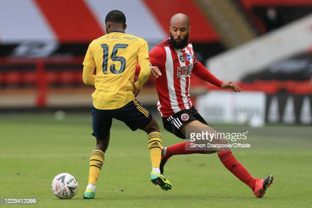 Ainsley Maitland-Niles of Arsenal battles with David McGoldrick of Sheff Utd during the FA Cup Fifth Quarter Final match between Sheffield United and...