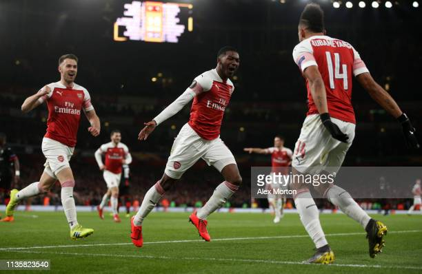 Ainsley MaitlandNiles of Arsenal celebrates after scoring his team's second goal during the UEFA Europa League Round of 16 Second Leg match between...